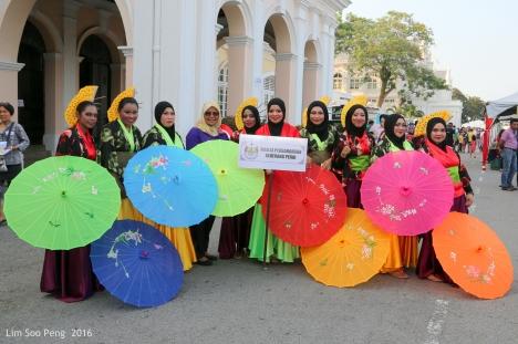 With the colourful umbrellas arranged randomly.