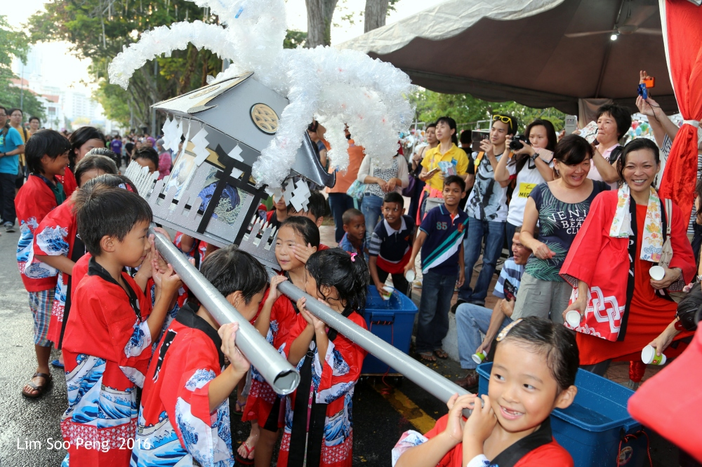 The Japanese children are having their share of fun at the Parade.
