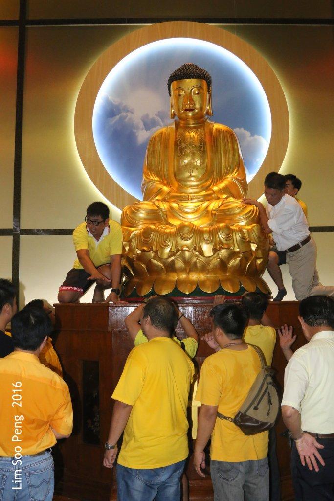 Moving the Buddha Image 158