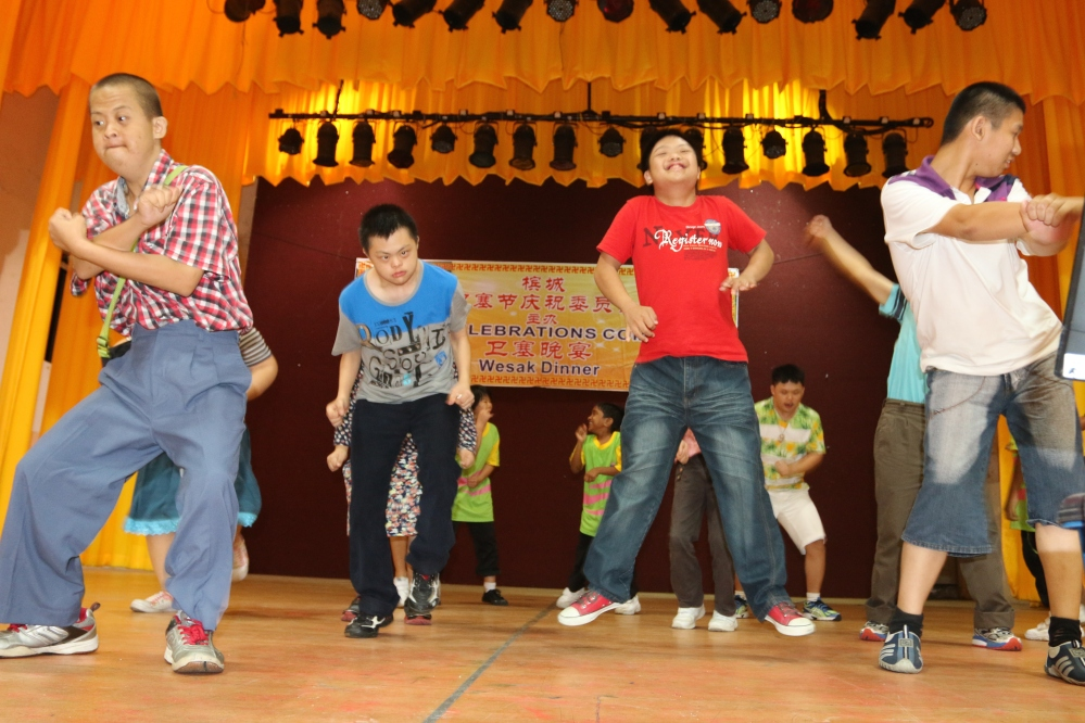 Jubilant Children enjoying themselves with the Gangnam Dance at the Wesak Charity Dinner 2016