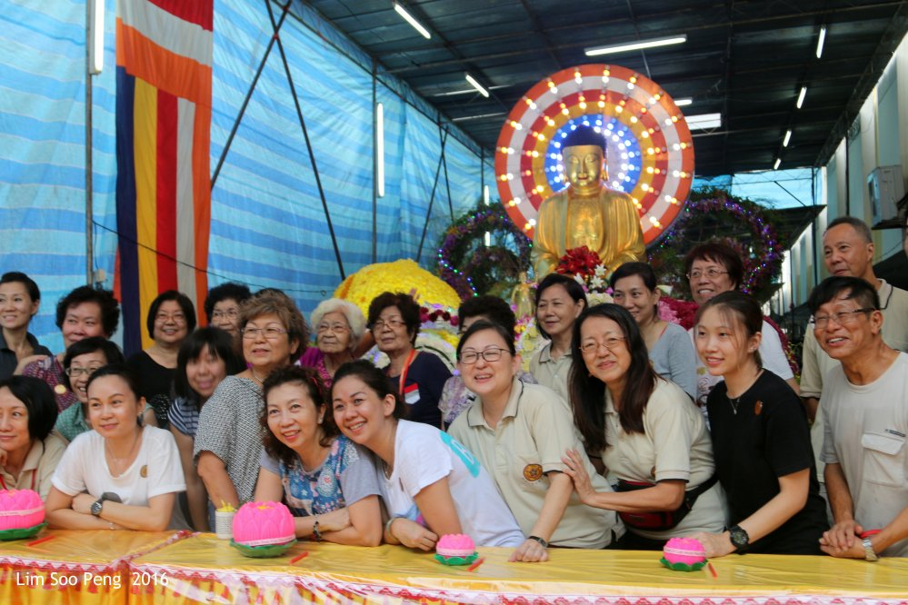 The Ohara Floral Arts Team decorating the Wesak Main Buddha Float.