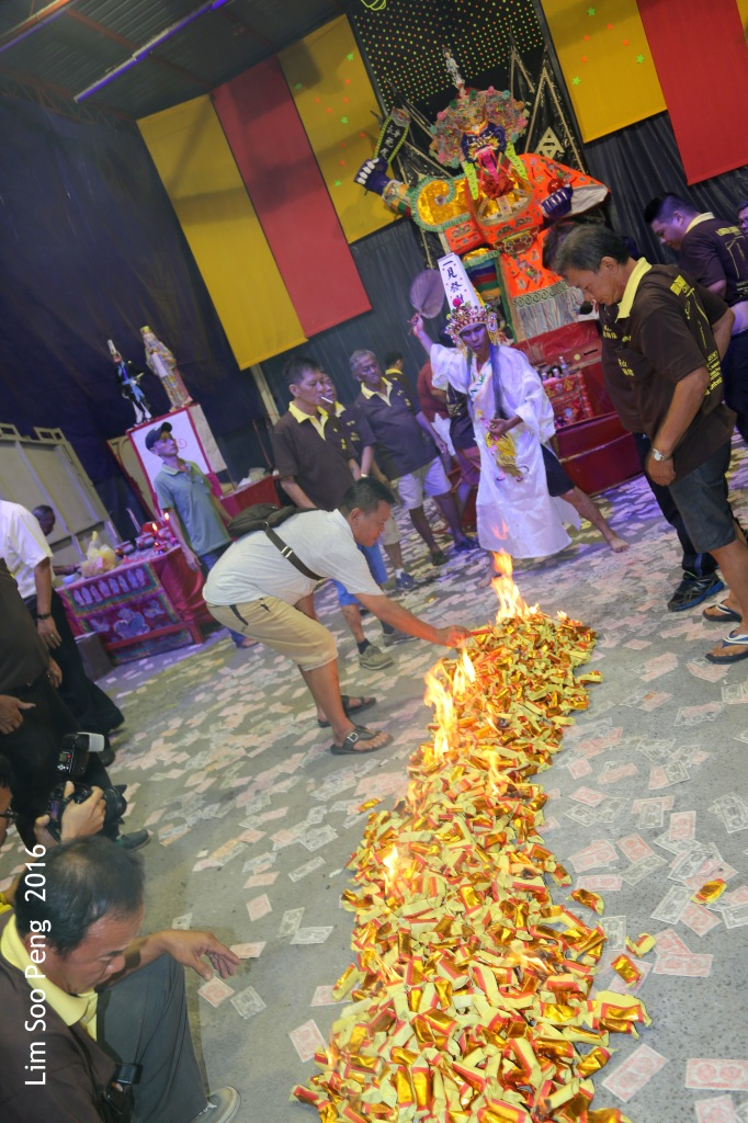 Celebrations of the Tai Soo Yah on Festival of the Hungry Ghost at Lim Jetty, Weld Quay, Penang on the final night of Monday, 22 August, 2016. The Medium Twa Pek starts the ceremony of lifting of the Tai Soo Yah paper effigy and following the trail of burnt joss paper.
