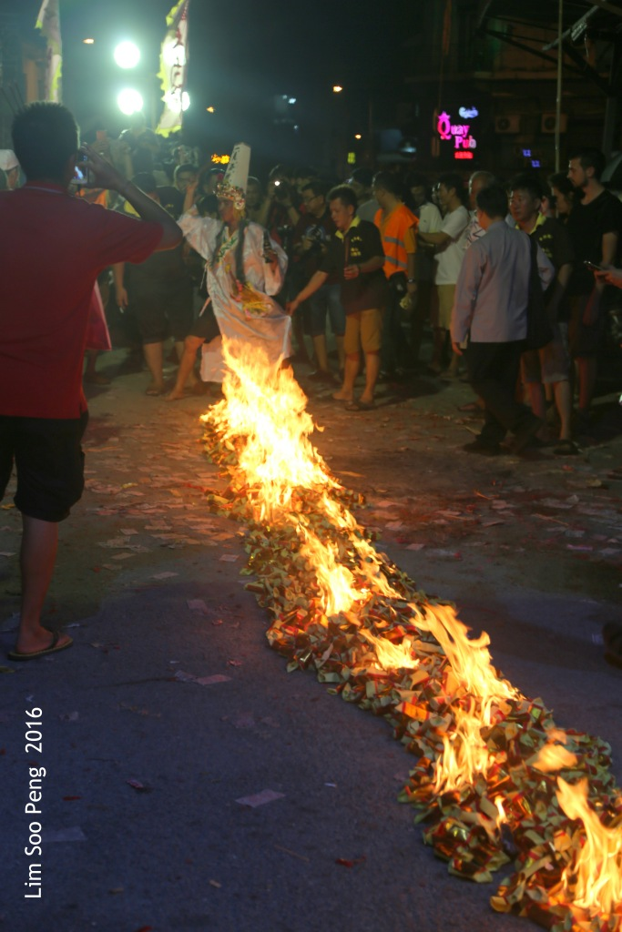 Celebrations of the Tai Soo Yah on Festival of the Hungry Ghost at Lim Jetty, Weld Quay, Penang on the final night of Monday, 22 August, 2016. Trail of burning joss paper.