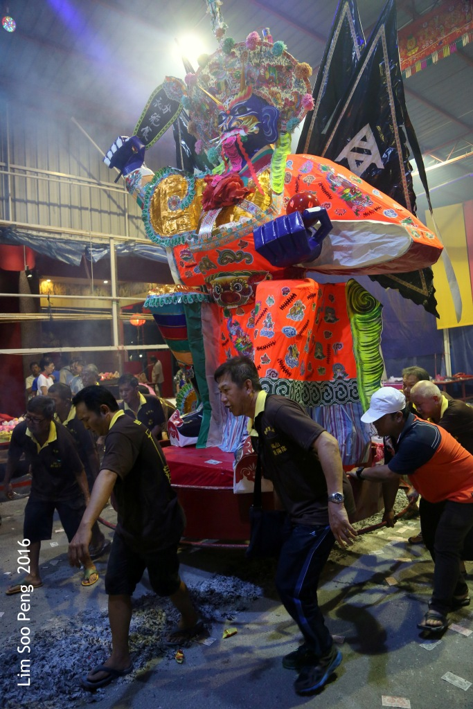 Celebrations of the Tai Soo Yah on Festival of the Hungry Ghost at Lim Jetty, Weld Quay, Penang on the final night of Monday, 22 August, 2016. Lifting of the Tai Soo Yah paper effigy and following the trail of burnt joss paper.