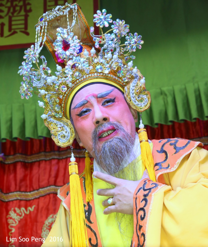 "Teochew Opera - The Murder Plot of the Emperor Part 2. "" A Murder Plot was hatched to poison the Emperor. The Concubine was to put the poison into Wine Jug. The Emperor was holding a cup of poisoned wine in his hand. He drank the wine and realised that it is poison. """
