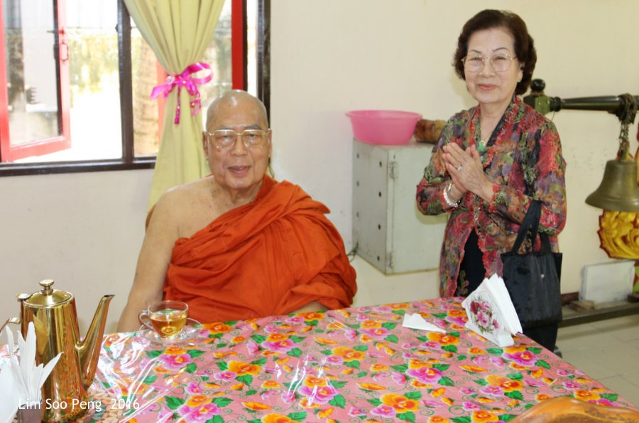 Dana for my Grandfather - the late Lim Chong Poh. Photograph of my mother with the Chief Monk of the Temple.