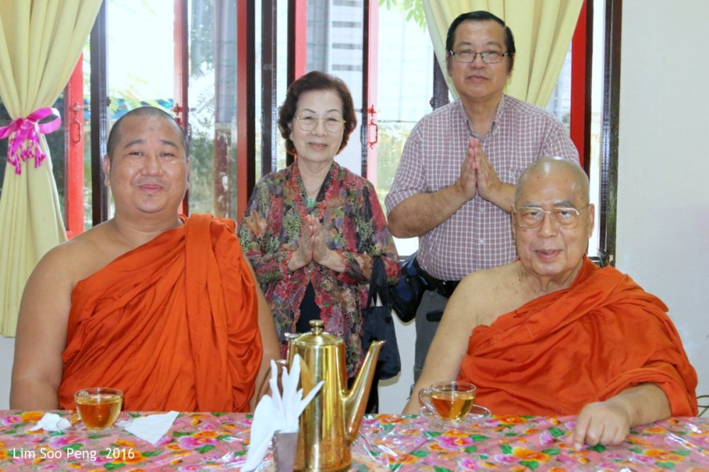 Dana for my Grandfather - the late Lim Chong Poh. Photograph with the Chief Monk of the Temple.