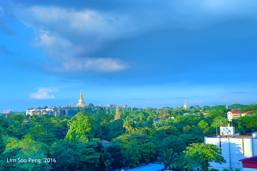 View of the Shwedagon or Golden Pagoda from the Taw Win Hotel. The Golden Stupa is 99 metres high and is made of 5.5 tons of gold.