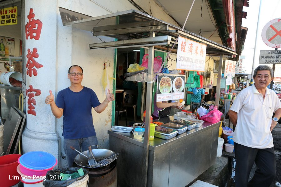 George Town's Street Photography - Friendly Food Vendor striking a friendly pose