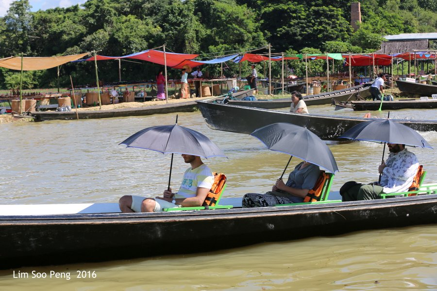 Day 4.7 - Our Burma Tour ~ Water Tour of Inle Lake. The black umbrella brigade on the boat.