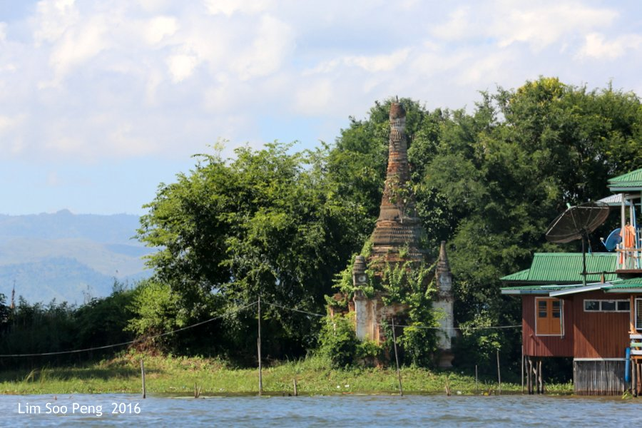 Day 4.7 - Our Burma Tour ~ Water Tour of Inle Lake. The old stupa and the new satellite dishes as time progresses.